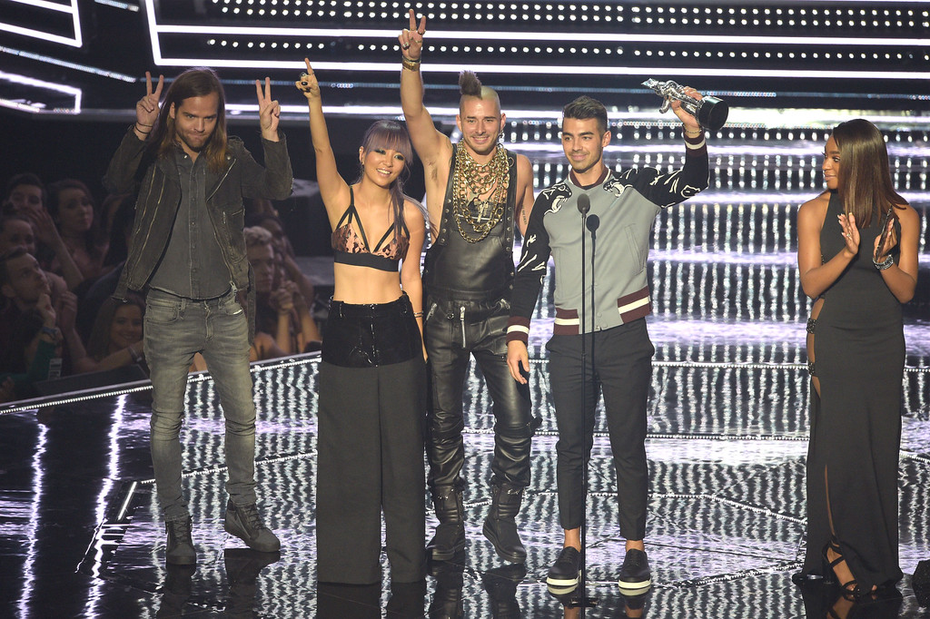 . NEW YORK, NY - AUGUST 28:  (L-R) Jack Lawless, JinJoo Lee, Cole Whittle and Joe Jonas of DNCE accepts the award for Best New Artist onstage during the 2016 MTV Video Music Awards at Madison Square Garden on August 28, 2016 in New York City.  (Photo by Jason Kempin/Getty Images)
