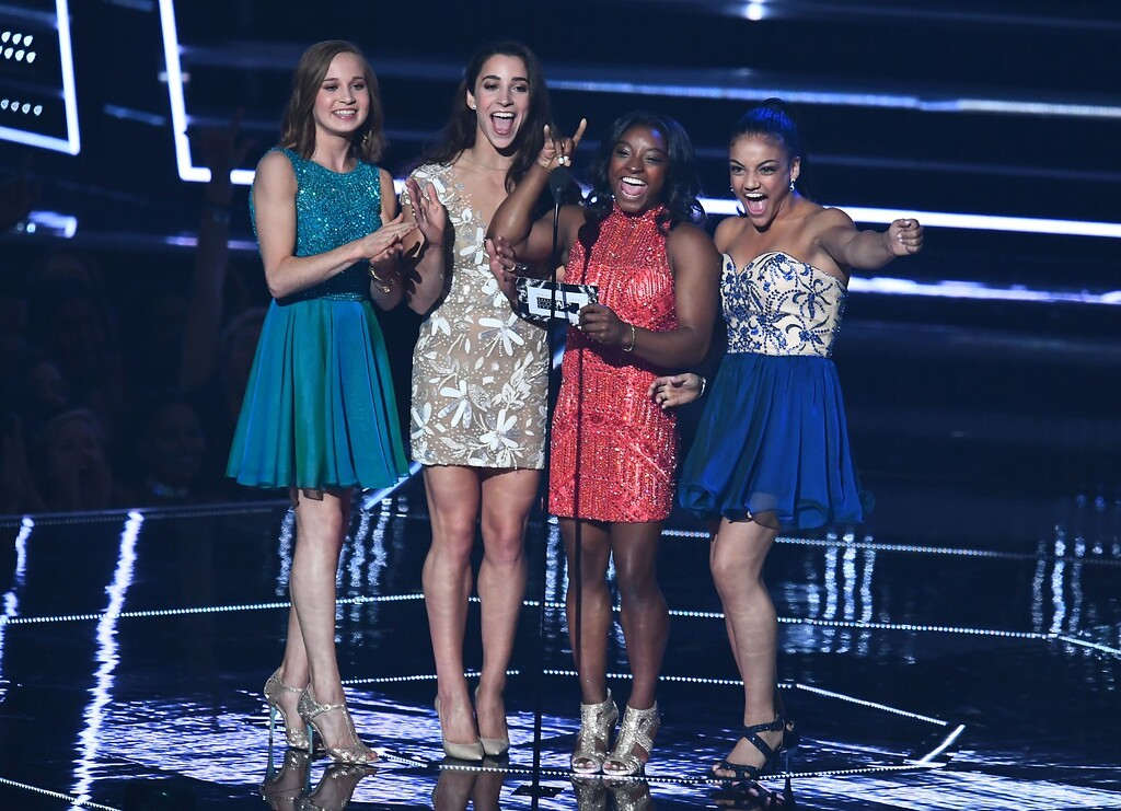 . (L-R) (L-R) Olympic gymnasts Madison Kocian, Aly Raisman, Simone Biles and Laurie Hernandez present during the 2016 MTV Video Music Awards August 28, 2016 at Madison Square Garden in New York. / AFP / Jewel SAMAD        (Photo credit should read JEWEL SAMAD/AFP/Getty Images)