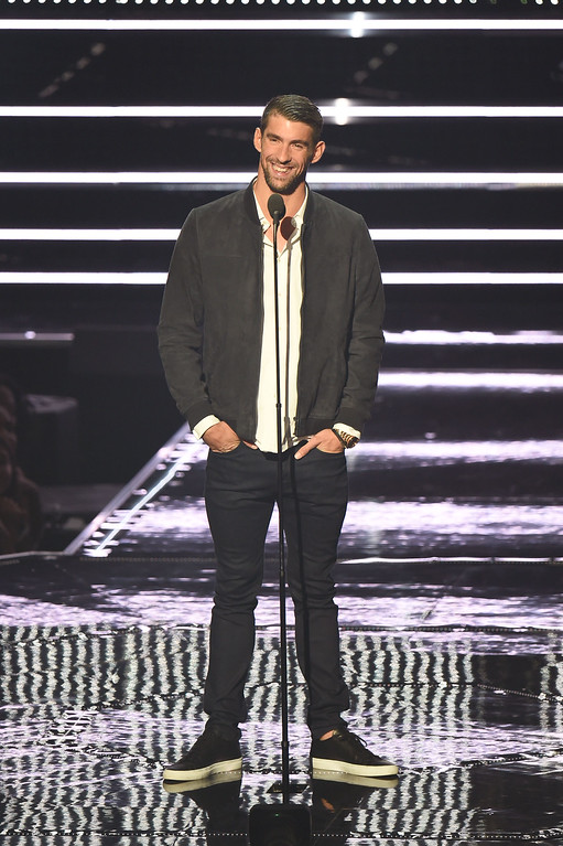 . NEW YORK, NY - AUGUST 28:  Michael Phelps presents onstage during the 2016 MTV Video Music Awards at Madison Square Garden on August 28, 2016 in New York City.  (Photo by Michael Loccisano/Getty Images)