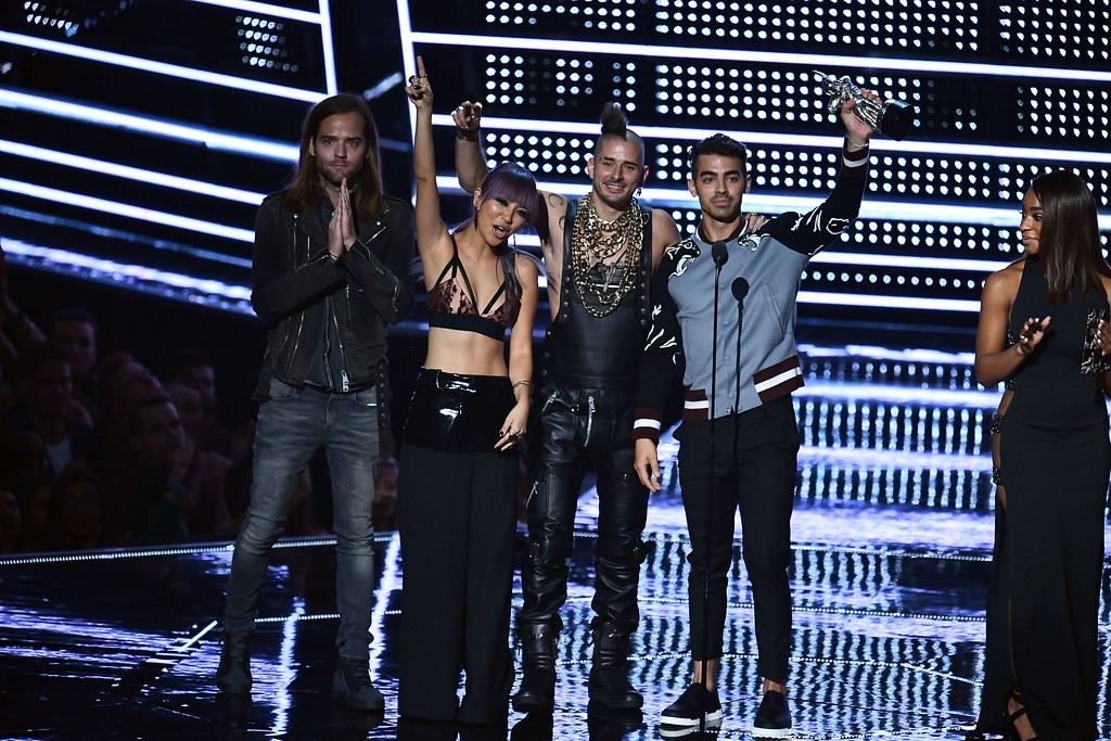 . (L-R) Jack Lawless, JinJoo Lee, Cole Whittle, and Joe Jonas of DNCE accept an award on stage during the 2016 MTV Video Music Award at the Madison Square Garden in New York on August 28, 2016. (JEWEL SAMAD/AFP/Getty Images)