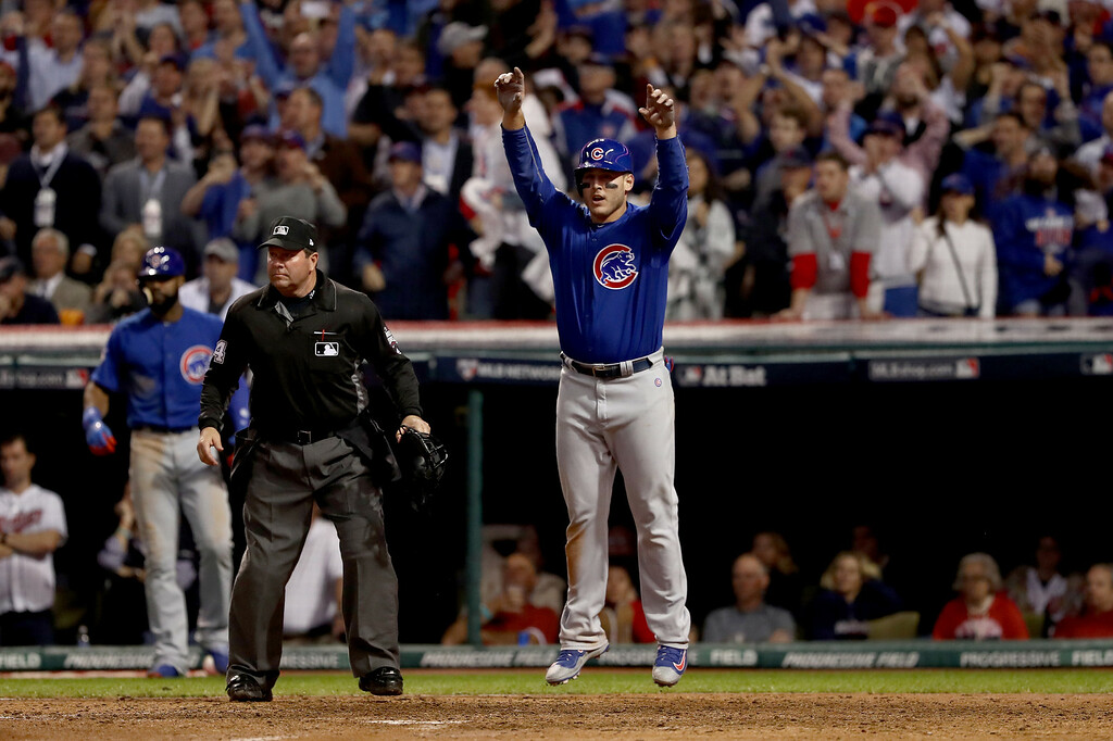 . CLEVELAND, OH - NOVEMBER 02:  Anthony Rizzo #44 of the Chicago Cubs celebrates after Rizzo scores a run in the 10th inning on a Miguel Montero #47 against the Cleveland Indians in Game Seven of the 2016 World Series at Progressive Field on November 2, 2016 in Cleveland, Ohio.  (Photo by Elsa/Getty Images)