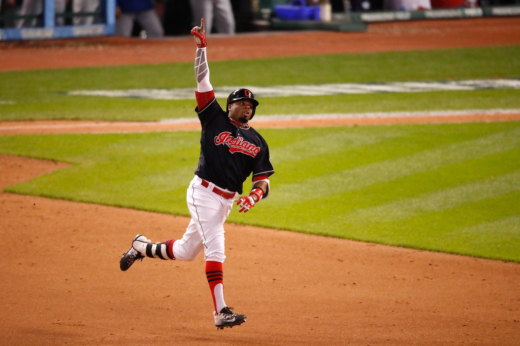. CLEVELAND, OH - NOVEMBER 02:  Rajai Davis #20 of the Cleveland Indians celebrates after hitting a two-run home run during the eighth inning to tie the game 6-6 against the Chicago Cubs in Game Seven of the 2016 World Series at Progressive Field on November 2, 2016 in Cleveland, Ohio.  (Photo by Gregory Shamus/Getty Images)