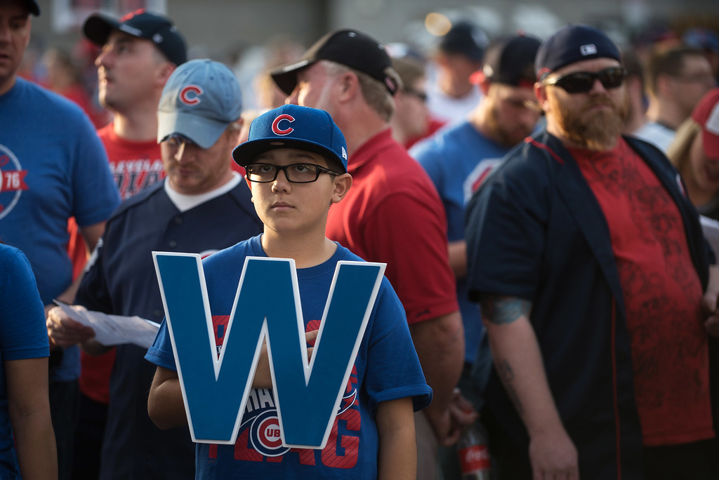 . CLEVELAND, OH - NOVEMBER 02: Chicago Cubs fan Christian Walkowiak, 10, of New Lenox, Ill., waits in line to get into Progressive Field before the start of Game 7 of the World Series between the Cleveland Indians and the Chicago Cubs on November 2, 2016 in Cleveland, Ohio. This marks the 37th Game 7 in World Series history. (Photo by Justin Merriman/Getty Images)