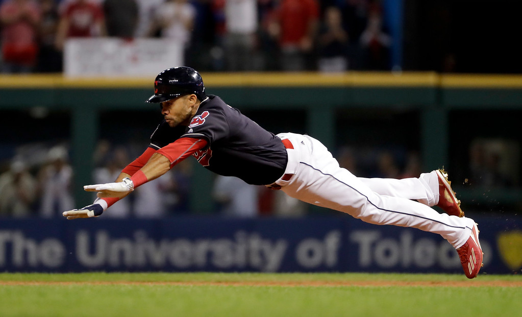 . Cleveland Indians\' Coco Crisp dives into second after a double against the Chicago Cubs during the third inning of Game 7 of the Major League Baseball World Series Wednesday, Nov. 2, 2016, in Cleveland. (AP Photo/Matt Slocum)