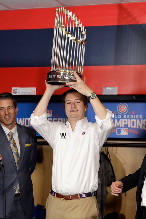 . CLEVELAND, OH - NOVEMBER 02:  Chicago Cubs owner Thomas S. Ricketts poses with The Commissioner\'s Trophy after the Chicago Cubs defeated the Cleveland Indians 8-7 in Game Seven of the 2016 World Series at Progressive Field on November 2, 2016 in Cleveland, Ohio. The Cubs win their first World Series in 108 years.  (Photo by David J. Phillip-Pool/Getty Images)