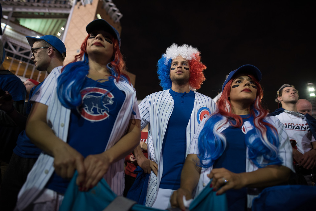 . CLEVELAND, OH - NOVEMBER 02: (L-R) Dayana Guzman, 38, Alex Marquez, 33, and Doraliz Guzman-Marquez, 35, all of Chicago cheer for the Cubs outside of Progressive Field during game 7 of the World Series between the Cleveland Indians and the Chicago Cubs on November 2, 2016 in Cleveland, Ohio. This marks the 37th Game 7 in World Series history. (Photo by Justin Merriman/Getty Images)