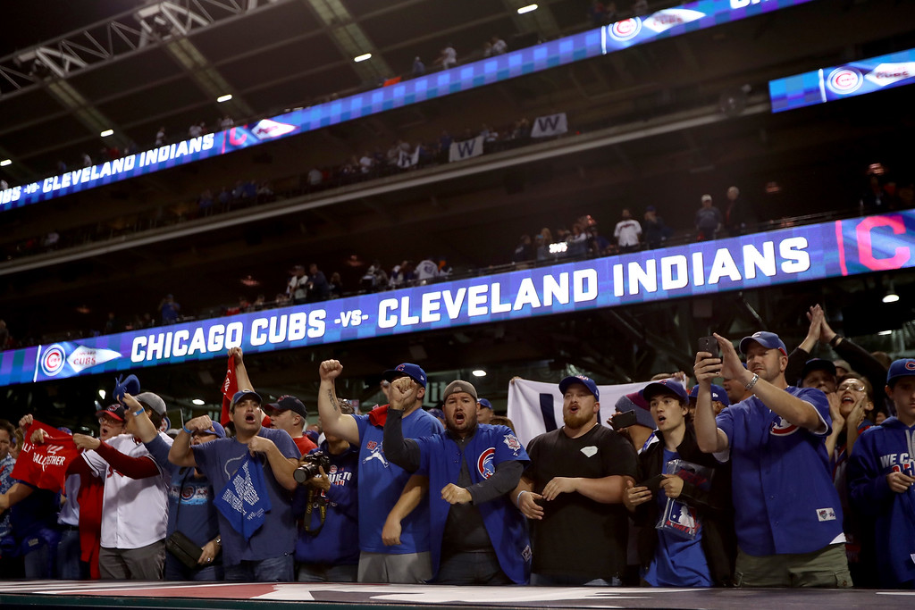. CLEVELAND, OH - NOVEMBER 01:  Chicago Cubs fans cheer after the Cubs defeated the Cleveland Indians 9-3 to win Game Six of the 2016 World Series at Progressive Field on November 1, 2016 in Cleveland, Ohio.  (Photo by Elsa/Getty Images)