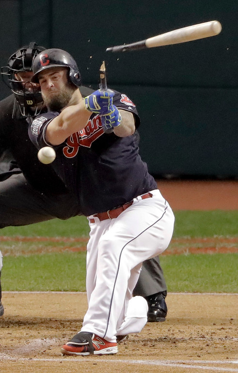 . Cleveland Indians\' Mike Napoli breaks his bat and grounds out against the Chicago Cubs during the first inning of Game 7 of the Major League Baseball World Series Wednesday, Nov. 2, 2016, in Cleveland. (AP Photo/Charlie Riedel)