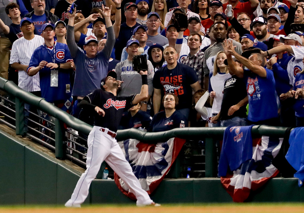 . Cleveland Indians right fielder Lonnie Chisenhall catches a fly ball hit by Chicago Cubs\' Willson Contreras during the second inning of Game 7 of the Major League Baseball World Series Wednesday, Nov. 2, 2016, in Cleveland. (AP Photo/Matt Slocum)