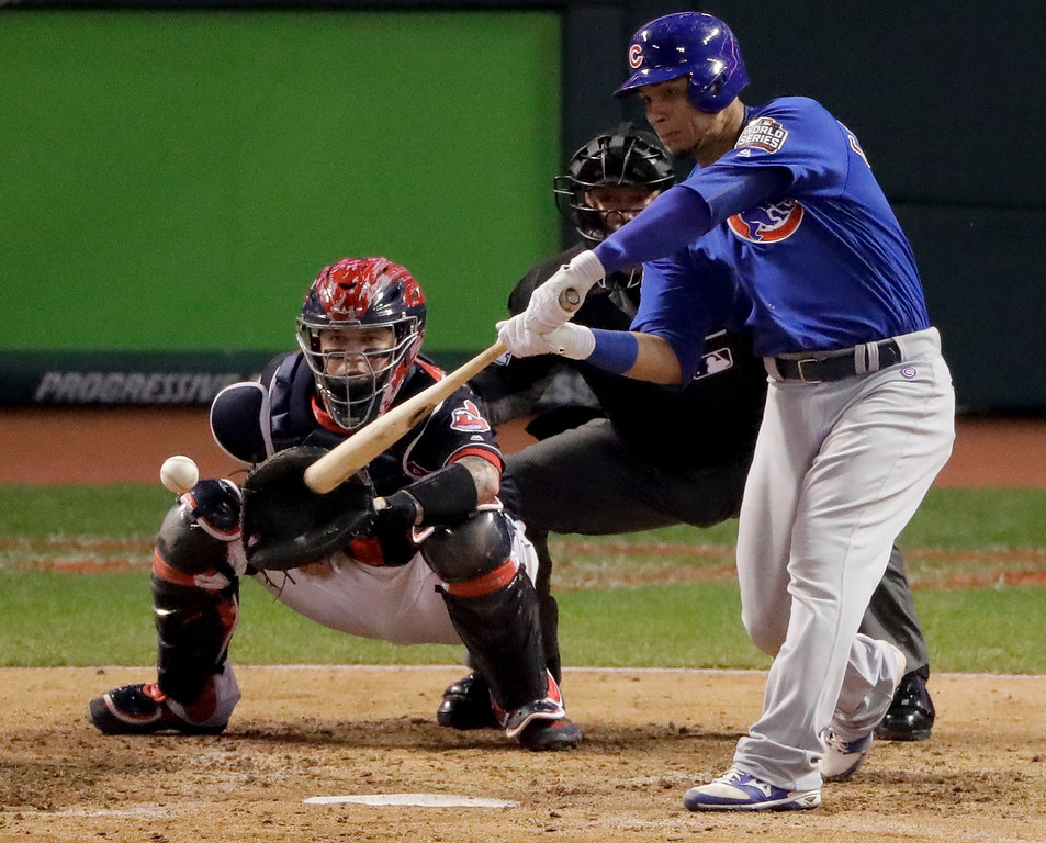 . Chicago Cubs\' Willson Contreras hits a RBI double against the Cleveland Indians during the fourth inning of Game 7 of the Major League Baseball World Series Wednesday, Nov. 2, 2016, in Cleveland. (AP Photo/Charlie Riedel)