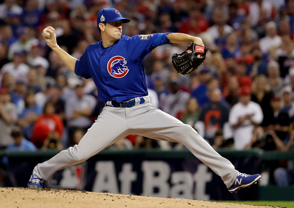 . Chicago Cubs starting pitcher Kyle Hendricks throws against the Cleveland Indians during the first inning of Game 7 of the Major League Baseball World Series Wednesday, Nov. 2, 2016, in Cleveland. (AP Photo/Matt Slocum)