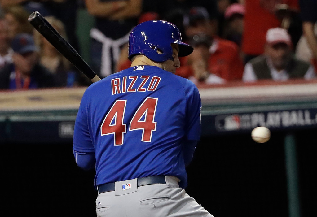 . Chicago Cubs\' Anthony Rizzo is hit by a pitch during the fourth inning of Game 7 of the Major League Baseball World Series against the Cleveland Indians Wednesday, Nov. 2, 2016, in Cleveland. (AP Photo/David J. Phillip)