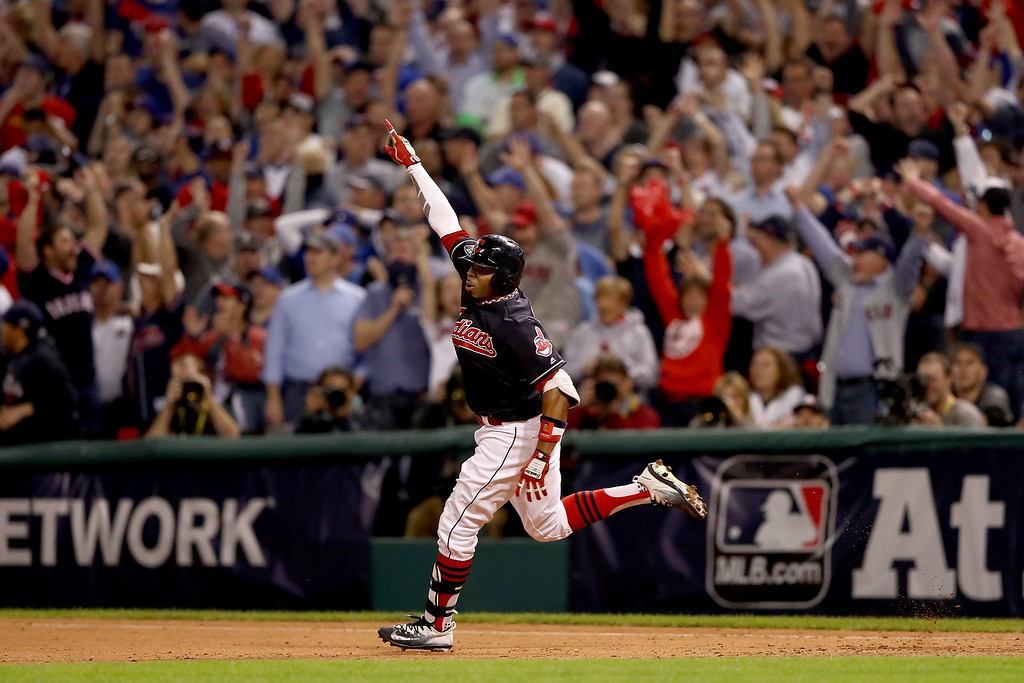 . CLEVELAND, OH - NOVEMBER 02:  Rajai Davis #20 of the Cleveland Indians celebrates after hitting a two-run home run during the eighth inning to tie the game 6-6 against the Chicago Cubs in Game Seven of the 2016 World Series at Progressive Field on November 2, 2016 in Cleveland, Ohio.  (Photo by Elsa/Getty Images)