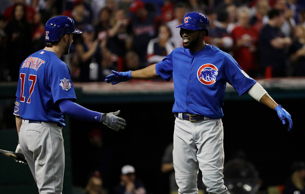 . Chicago Cubs\' Dexter Fowler celebrates with Kris Bryant after hitting a home run during the first inning of Game 7 of the Major League Baseball World Series against the Cleveland Indians Wednesday, Nov. 2, 2016, in Cleveland. (AP Photo/David J. Phillip)