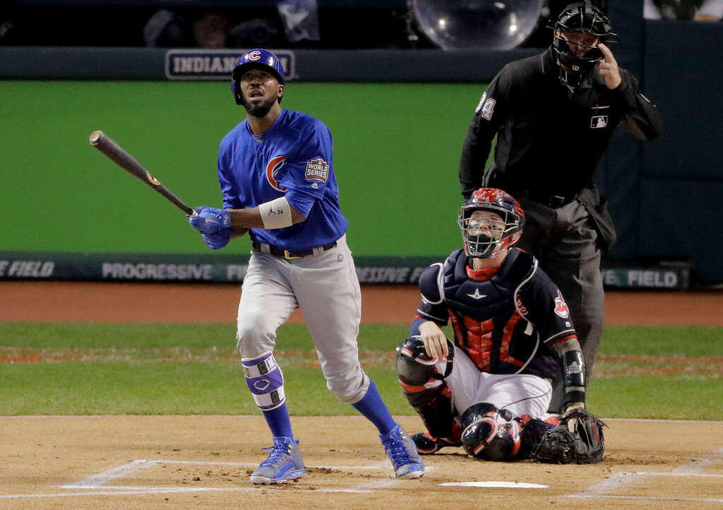. Chicago Cubs\' Dexter Fowler watches his home run against the Cleveland Indians during the first inning of Game 7 of the Major League Baseball World Series Wednesday, Nov. 2, 2016, in Cleveland. (AP Photo/Charlie Riedel)