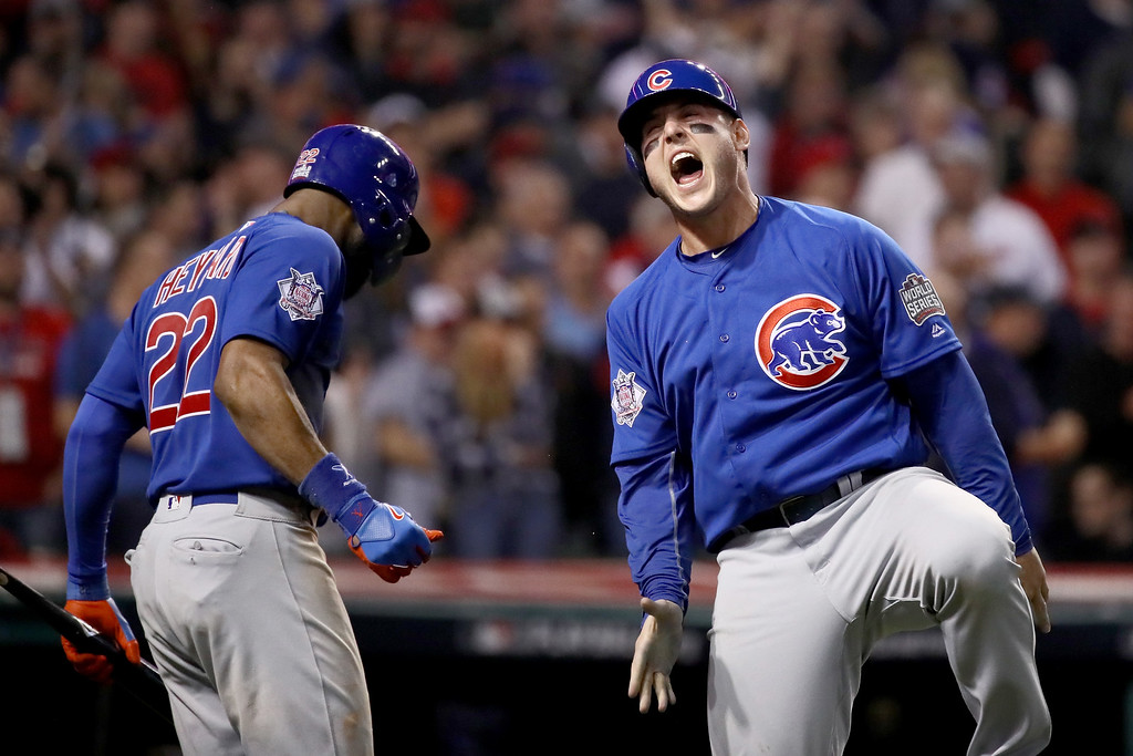 . CLEVELAND, OH - NOVEMBER 02:  Anthony Rizzo #44 of the Chicago Cubs celebrates with Jason Heyward #22 after Rizzo scores a run in the 10th inning on a Miguel Montero #47 against the Cleveland Indians in Game Seven of the 2016 World Series at Progressive Field on November 2, 2016 in Cleveland, Ohio.  (Photo by Ezra Shaw/Getty Images)