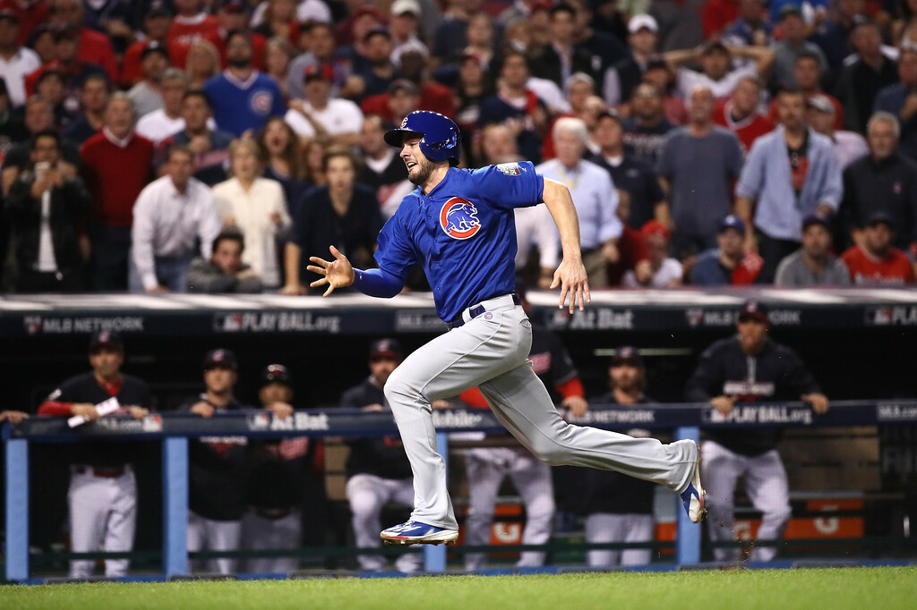 . CLEVELAND, OH - NOVEMBER 02:  Kris Bryant #17 of the Chicago Cubs runs to home plate to score a run on a sacrifice fly ball hit by Addison Russell #27 (not pictured) during the fourth inning against the Cleveland Indians in Game Seven of the 2016 World Series at Progressive Field on November 2, 2016 in Cleveland, Ohio.  (Photo by Ezra Shaw/Getty Images)