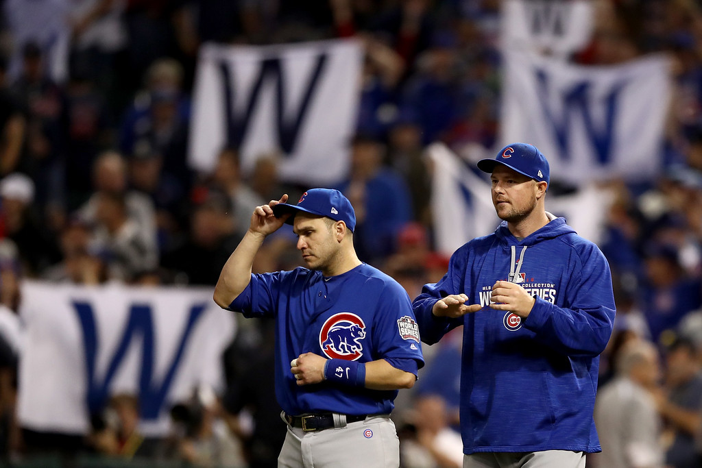 . CLEVELAND, OH - NOVEMBER 01:  Miguel Montero #47 and Jon Lester #34 of the Chicago Cubs react after defeating the Cleveland Indians 9-3 to win Game Six of the 2016 World Series at Progressive Field on November 1, 2016 in Cleveland, Ohio.  (Photo by Elsa/Getty Images)