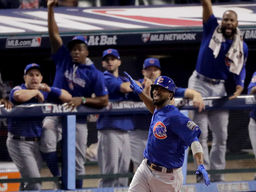 . Chicago Cubs\' Dexter Fowler celebrates after a home run against the Cleveland Indians during the first inning of Game 7 of the Major League Baseball World Series Wednesday, Nov. 2, 2016, in Cleveland. (AP Photo/Charlie Riedel)