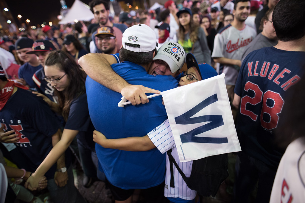 . CLEVELAND, OH - NOVEMBER 02: Chicago Cubs fans hug outside of Progressive Field after game 7 of the World Series between the Cleveland Indians and the Chicago Cubs on November 2, 2016 in Cleveland, Ohio. The Cubs defeated the Indians 8-7 in 10 innings for their first World Series championship in 108 years. (Photo by Justin Merriman/Getty Images)