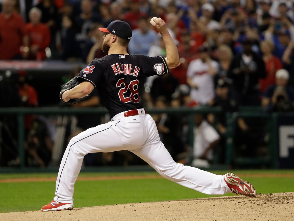 . Cleveland Indians starting pitcher Corey Kluber throws before Game 7 of the Major League Baseball World Series against the Chicago Cubs Wednesday, Nov. 2, 2016, in Cleveland. (AP Photo/David J. Phillip)