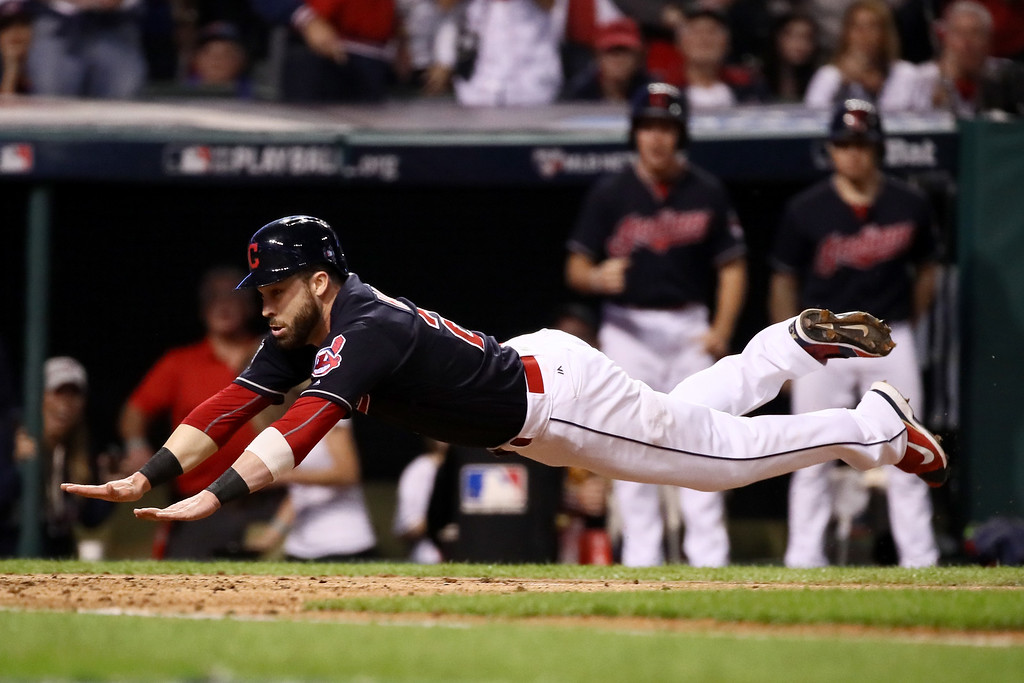 . CLEVELAND, OH - NOVEMBER 02:  Jason Kipnis #22 of the Cleveland Indians scores a run on a wild pitch thrown by Jon Lester #34 of the Chicago Cubs (not pictured) during the fifth inning in Game Seven of the 2016 World Series at Progressive Field on November 2, 2016 in Cleveland, Ohio.  (Photo by Ezra Shaw/Getty Images)