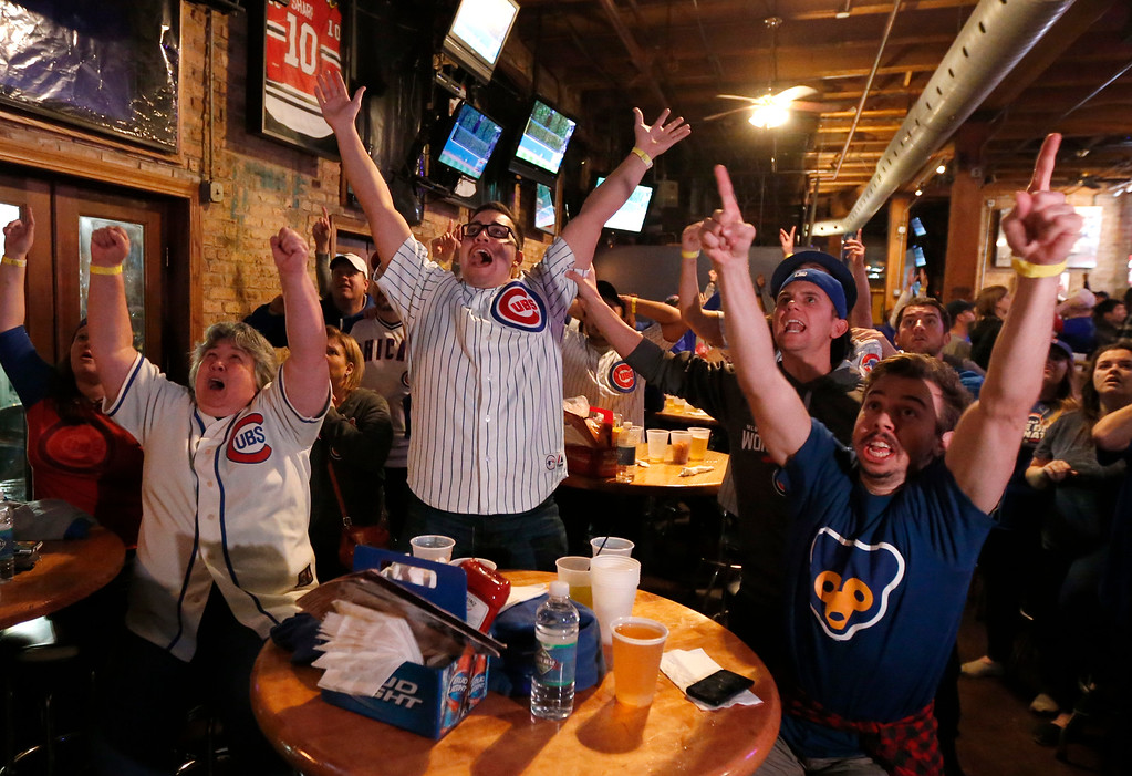 . Chicago Cubs fans celebrate at the Cubby Bear bar across the street from Wrigley Field in Chicago on Wednesday, Nov. 2, 2016, after Dexter Fowler\'s first-inning home run during Game 7 of the Major League Baseball World Series in Cleveland. (AP Photo/Charles Rex Arbogast)