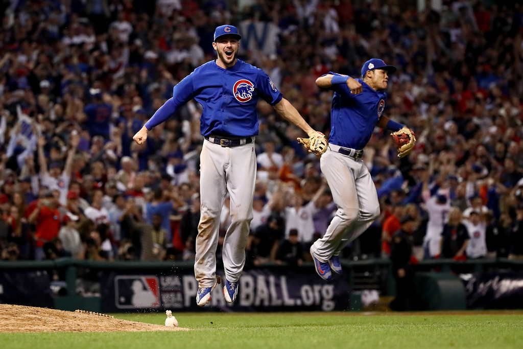 . CLEVELAND, OH - NOVEMBER 02:  Kris Bryant #17 and Addison Russell #27 of the Chicago Cubs celebrate after defeating the Cleveland Indians 8-7 in Game Seven of the 2016 World Series at Progressive Field on November 2, 2016 in Cleveland, Ohio. The Cubs win their first World Series in 108 years.  (Photo by Ezra Shaw/Getty Images)