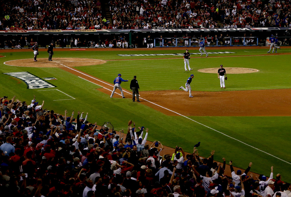 . CLEVELAND, OH - NOVEMBER 01:  Addison Russell #27 of the Chicago Cubs celebrates as he runs the bases after hitting a grand slam home run during the third inning against the Cleveland Indians in Game Six of the 2016 World Series at Progressive Field on November 1, 2016 in Cleveland, Ohio.  (Photo by Ezra Shaw/Getty Images)