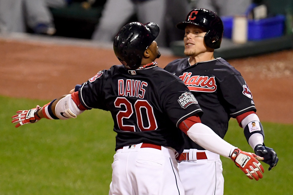 . CLEVELAND, OH - NOVEMBER 02:  Rajai Davis #20 of the Cleveland Indians celebrates with Brandon Guyer #6 after hitting a two-run home run during the eighth inning to tie the game 6-6 against the Chicago Cubs in Game Seven of the 2016 World Series at Progressive Field on November 2, 2016 in Cleveland, Ohio.  (Photo by Jason Miller/Getty Images)