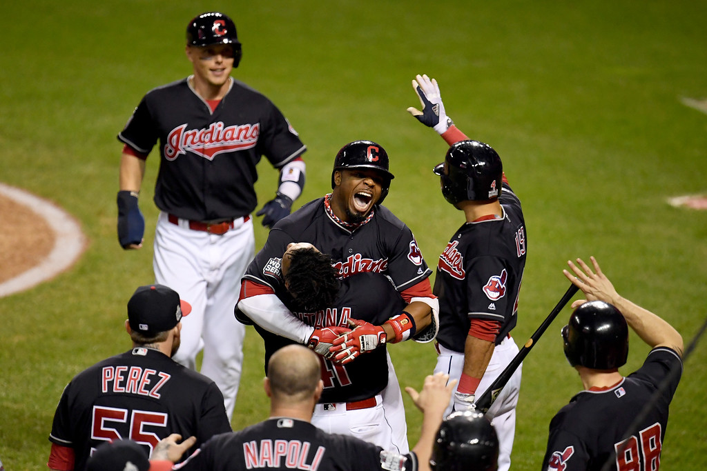 . CLEVELAND, OH - NOVEMBER 02:  Rajai Davis #20 of the Cleveland Indians celebrates with teammates after hitting a two-run home run during the eighth inning to tie the game 6-6 against the Chicago Cubs in Game Seven of the 2016 World Series at Progressive Field on November 2, 2016 in Cleveland, Ohio.  (Photo by Jason Miller/Getty Images)