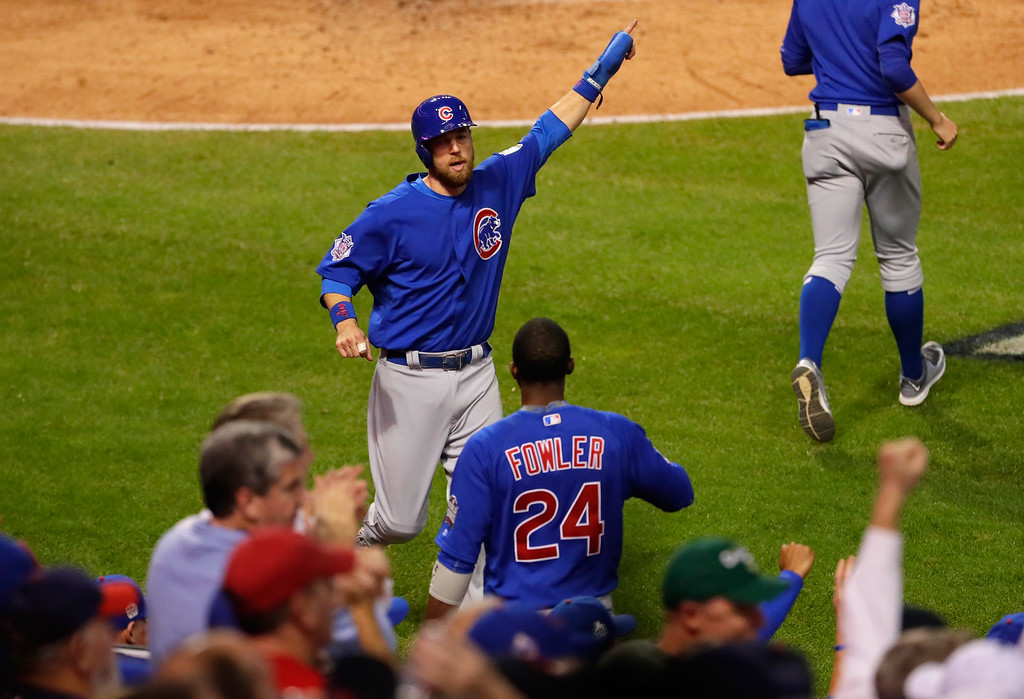 . CLEVELAND, OH - NOVEMBER 02:  Ben Zobrist #18 of the Chicago Cubs reacts after scoring a run on an RBI double hit by Willson Contreras #40 (not pictured) during the fourth inning against the Cleveland Indians in Game Seven of the 2016 World Series at Progressive Field on November 2, 2016 in Cleveland, Ohio.  (Photo by Jamie Squire/Getty Images)