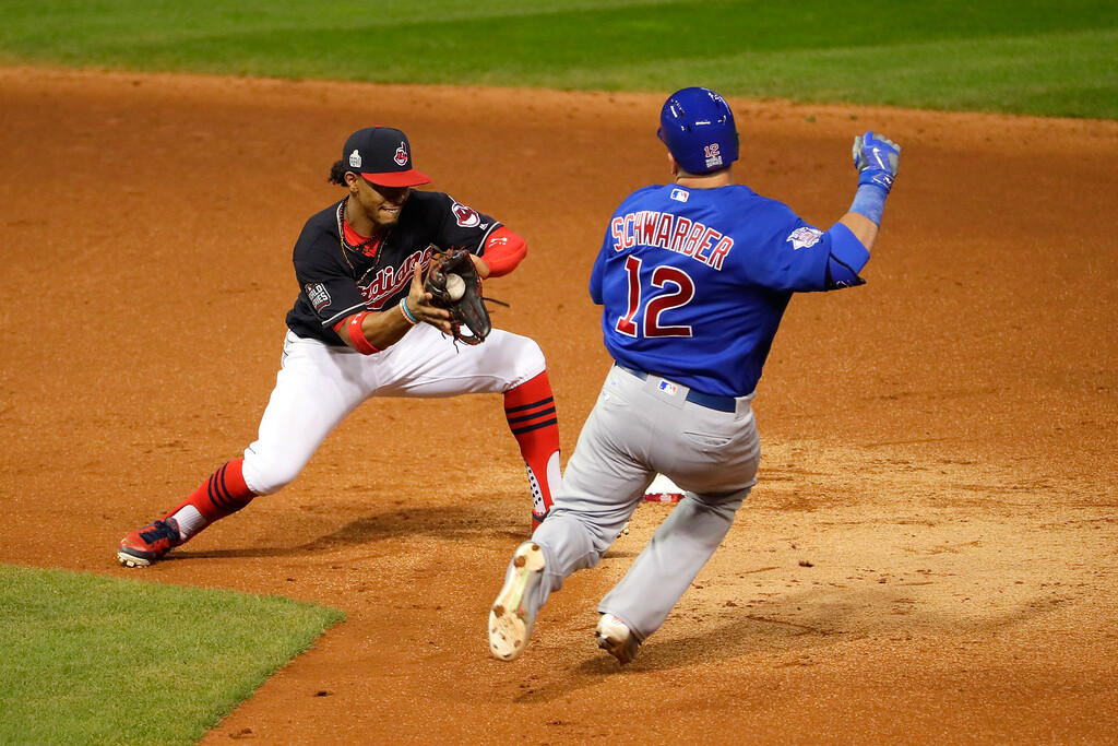 . CLEVELAND, OH - NOVEMBER 02:  Francisco Lindor #12 of the Cleveland Indians tags out Kyle Schwarber #12 of the Chicago Cubs as he attempts to stretch the play after hitting a single during the third inning in Game Seven of the 2016 World Series at Progressive Field on November 2, 2016 in Cleveland, Ohio.  (Photo by Jamie Squire/Getty Images)