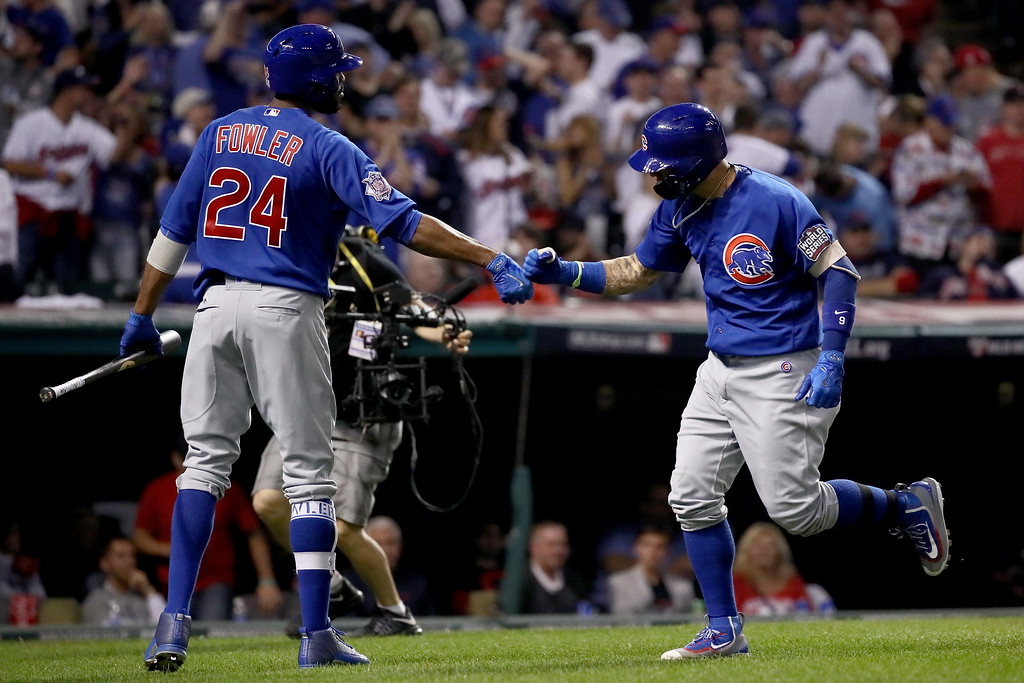 . CLEVELAND, OH - NOVEMBER 02:  Javier Baez #9 of the Chicago Cubs celebrates with Dexter Fowler #24 after hitting a solo home run during the fifth inning against the Cleveland Indians in Game Seven of the 2016 World Series at Progressive Field on November 2, 2016 in Cleveland, Ohio.  (Photo by Ezra Shaw/Getty Images)
