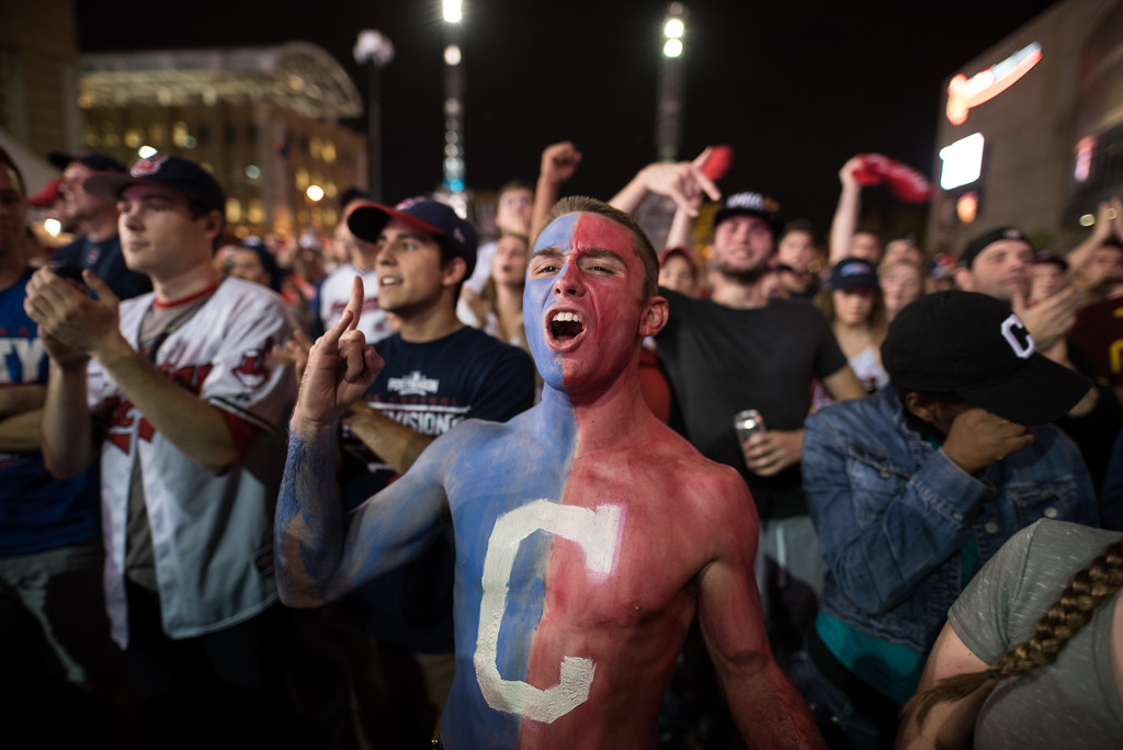 . CLEVELAND, OH - NOVEMBER 02: Cam Lathem, 21, of Ashville, Ohio cheers on the Indians outside of Progressive Field during game 7 of the World Series between the Cleveland Indians and the Chicago Cubs on November 2, 2016 in Cleveland, Ohio. The Cleveland Indians are looking to secure their first World Series championship since 1948. (Photo by Justin Merriman/Getty Images)