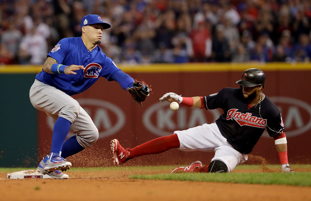. Chicago Cubs\' Javier Baez can\'t handle the ball as Cleveland Indians\' Carlos Santana slides safely into second during the third inning of Game 7 of the Major League Baseball World Series Wednesday, Nov. 2, 2016, in Cleveland. (AP Photo/Matt Slocum)