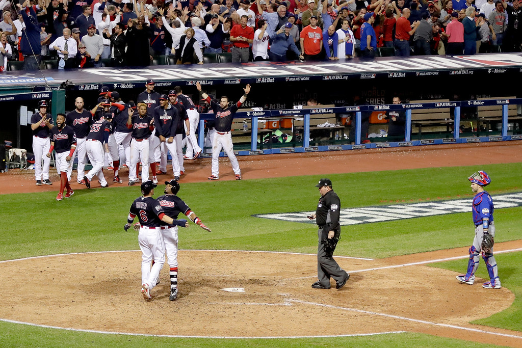 . CLEVELAND, OH - NOVEMBER 02:  Rajai Davis #20 of the Cleveland Indians celebrates with Brandon Guyer #6 after hitting a two-run home run during the eighth inning to tie the game 6-6 against the Chicago Cubs in Game Seven of the 2016 World Series at Progressive Field on November 2, 2016 in Cleveland, Ohio.  (Photo by Jamie Squire/Getty Images)