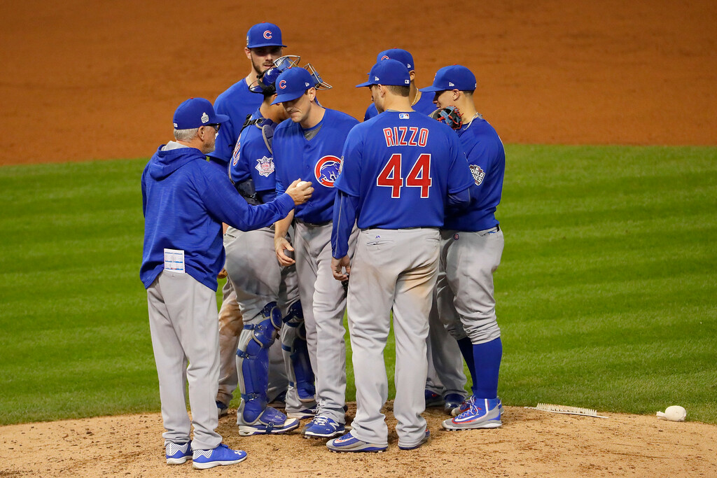 . CLEVELAND, OH - NOVEMBER 02:  Kyle Hendricks #28 of the Chicago Cubs is relieved by manager Joe Maddon during the fifth inning against the Cleveland Indians in Game Seven of the 2016 World Series at Progressive Field on November 2, 2016 in Cleveland, Ohio.  (Photo by Jamie Squire/Getty Images)