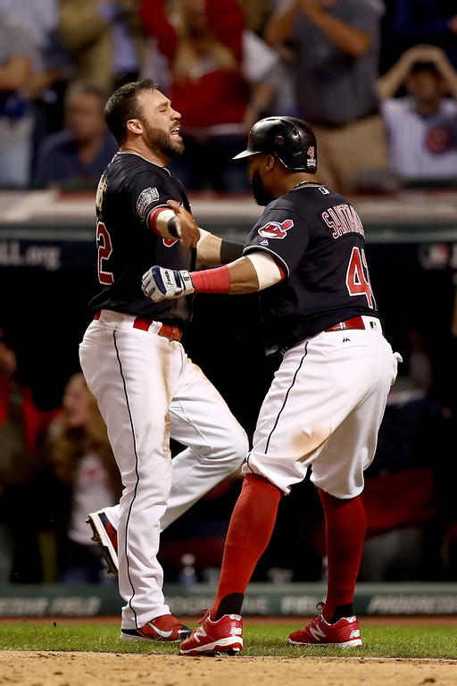 . CLEVELAND, OH - NOVEMBER 02:  Jason Kipnis #22 and Carlos Santana #41 of the Cleveland Indians celebrate after scoring runs on a wild pitch thrown by Jon Lester #34 of the Chicago Cubs (not pictured) during the fifth inning in Game Seven of the 2016 World Series at Progressive Field on November 2, 2016 in Cleveland, Ohio.  (Photo by Elsa/Getty Images)