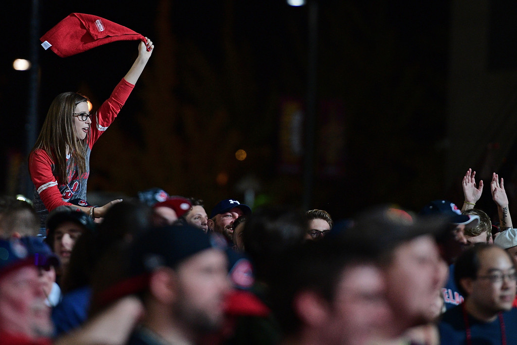 . A Cleveland Indians fan waives a rally towel during a watch party for Game 7 of the baseball World Series between the Indians and the Chicago Cubs, outside Progressive Field, Wednesday, Nov. 2, 2016, in Cleveland. (AP Photo/David Dermer)