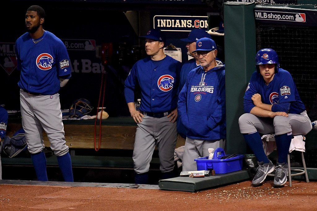 . CLEVELAND, OH - NOVEMBER 02:  Joe Maddon #70 of the Chicago Cubs looks on from the dugout against the Cleveland Indians in Game Seven of the 2016 World Series at Progressive Field on November 2, 2016 in Cleveland, Ohio.  (Photo by Jason Miller/Getty Images)