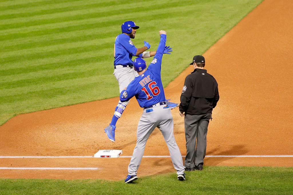 . CLEVELAND, OH - NOVEMBER 02:  Dexter Fowler #24 of the Chicago Cubs celebrates with first base coach Brandon Hyde #16 after hitting a lead off home run in the first inning against the Cleveland Indians in Game Seven of the 2016 World Series at Progressive Field on November 2, 2016 in Cleveland, Ohio.  (Photo by Jamie Squire/Getty Images)