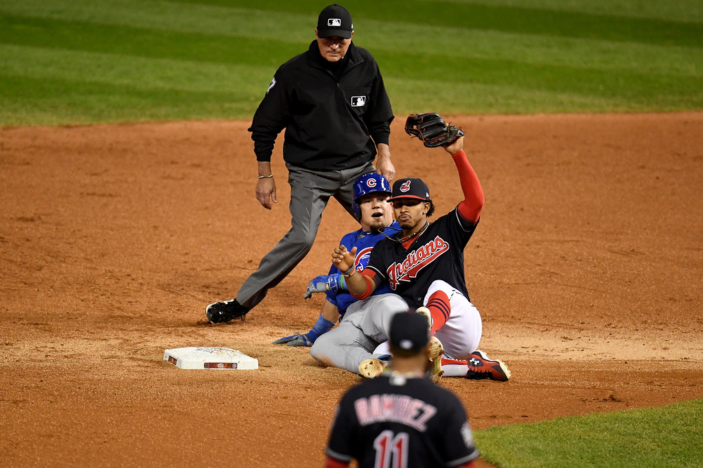 . CLEVELAND, OH - NOVEMBER 02:  Francisco Lindor #12 of the Cleveland Indians reacts after tagging out Kyle Schwarber #12 of the Chicago Cubs as he attempts to stretch the play after hitting a single during the third inning in Game Seven of the 2016 World Series at Progressive Field on November 2, 2016 in Cleveland, Ohio.  (Photo by Jason Miller/Getty Images)