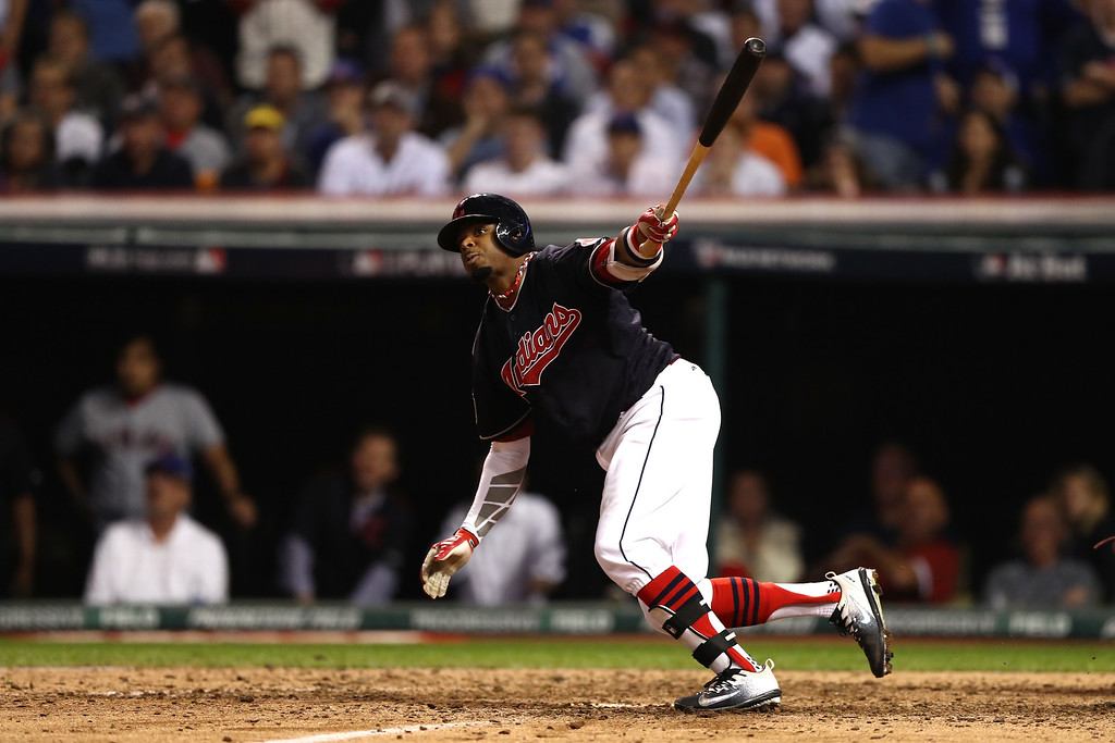 . CLEVELAND, OH - NOVEMBER 02:  Rajai Davis #20 of the Cleveland Indians hits a two-run home run during the eighth inning to tie the game 6-6 against the Chicago Cubs in Game Seven of the 2016 World Series at Progressive Field on November 2, 2016 in Cleveland, Ohio.  (Photo by Elsa/Getty Images)
