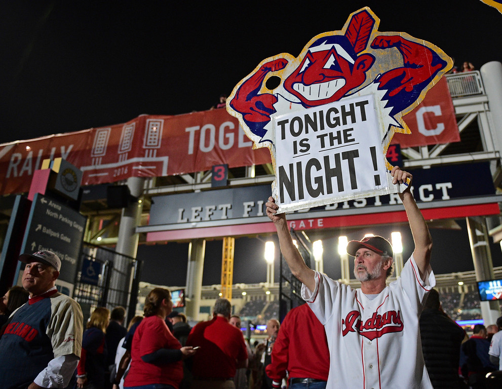 . Cleveland Indians fan Jim Stamper holds a sign during a watch party for Game 7 of the baseball World Series between the Indians and the Chicago Cubs, outside Progressive Field, Wednesday, Nov. 2, 2016, in Cleveland. (AP Photo/David Dermer)