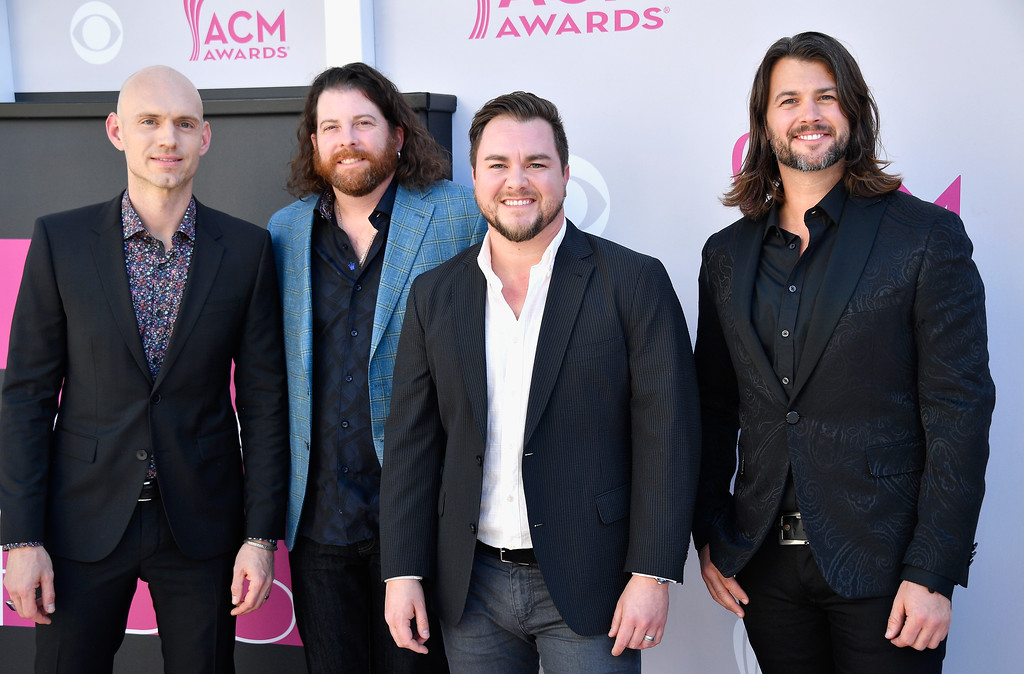 . LAS VEGAS, NV - APRIL 02:  (L-R) Recording artists Jon Jones, James Young, Mike Eli, and Chris Thompson of music group Eli Young Band attend the 52nd Academy Of Country Music Awards at Toshiba Plaza on April 2, 2017 in Las Vegas, Nevada.  (Photo by Frazer Harrison/Getty Images)