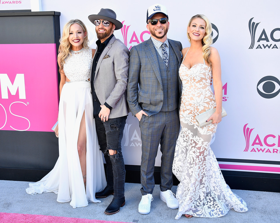 . LAS VEGAS, NV - APRIL 02:  (L-R) Kristen White, musicians Preston Brust and Chris Lucas of LOCASH, and Kaitlyn Lucas attend the 52nd Academy Of Country Music Awards at Toshiba Plaza on April 2, 2017 in Las Vegas, Nevada.  (Photo by Frazer Harrison/Getty Images)