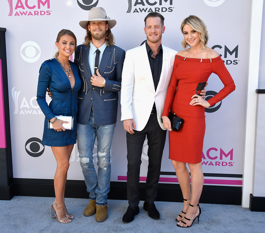 . LAS VEGAS, NV - APRIL 02:  (L-R) Brittney Marie Cole, recording artists Brian Kelley and Tyler Hubbard of music group Florida Georgia Line, and Hayley Stommel attend the 52nd Academy Of Country Music Awards at Toshiba Plaza on April 2, 2017 in Las Vegas, Nevada.  (Photo by Frazer Harrison/Getty Images)
