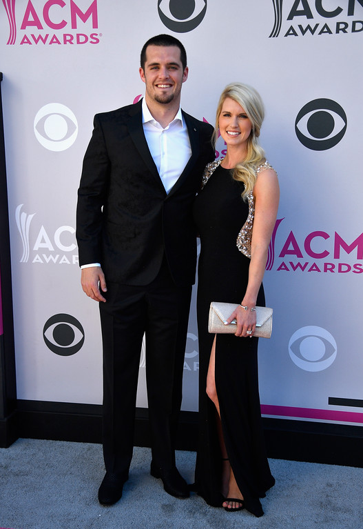 . LAS VEGAS, NV - APRIL 02:  NFL player Derek Carr (L) and Heather Neel attend the 52nd Academy Of Country Music Awards at Toshiba Plaza on April 2, 2017 in Las Vegas, Nevada.  (Photo by Frazer Harrison/Getty Images)