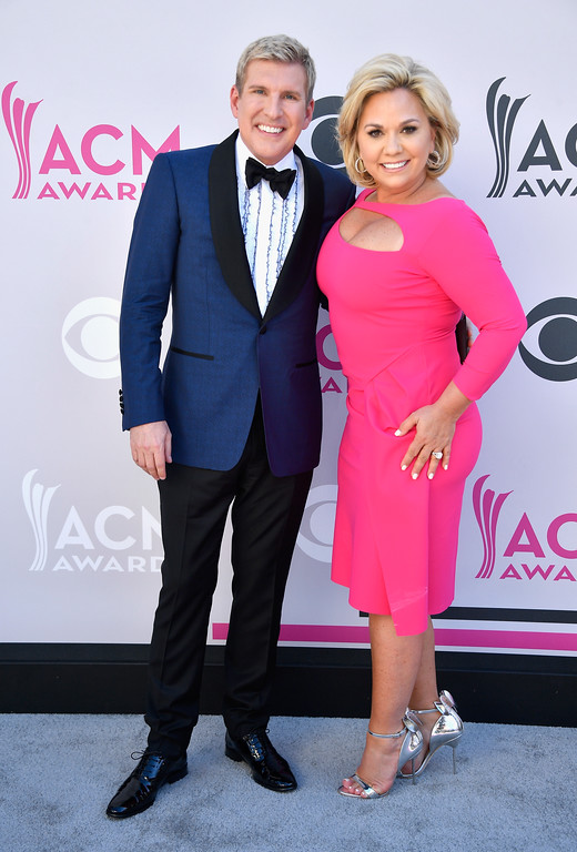 . LAS VEGAS, NV - APRIL 02:  TV personalities Todd Chrisley (L) and Julie Chrisley attend the 52nd Academy Of Country Music Awards at Toshiba Plaza on April 2, 2017 in Las Vegas, Nevada.  (Photo by Frazer Harrison/Getty Images)